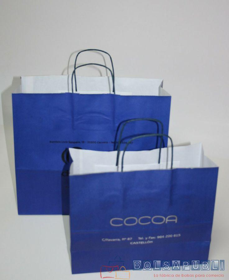Bolsapubli - Bolsas klein con asa rizada, en color azul e impresas en color plata.