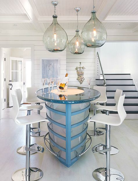 Nautical theme ship shaped kitchen island: http://www.completely-coastal.com/2015/09/beach-cottage-look-shiplap-wall-paneling-painted-white.html