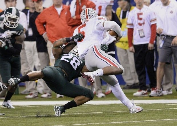 MSU's Denicos Allen makes a  fourth down stop of Ohio State quarterback Braxton Miller late in MSU's   34-24 win  at the   Big Ten Championship football game Saturday 12/7/2013.   MSU will be heading to the Rose Bowl.