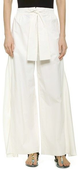 Acne Studios Eddiese Wide Leg Trousers These crisp Acne Studios trousers cut a bold, wide-leg silhouette with breezy crepe side panels. A nautical tie waist adds classic appeal. Smocked elastic waist. On-seam hip pockets and single patch back pocket. Button closure and zip fly.