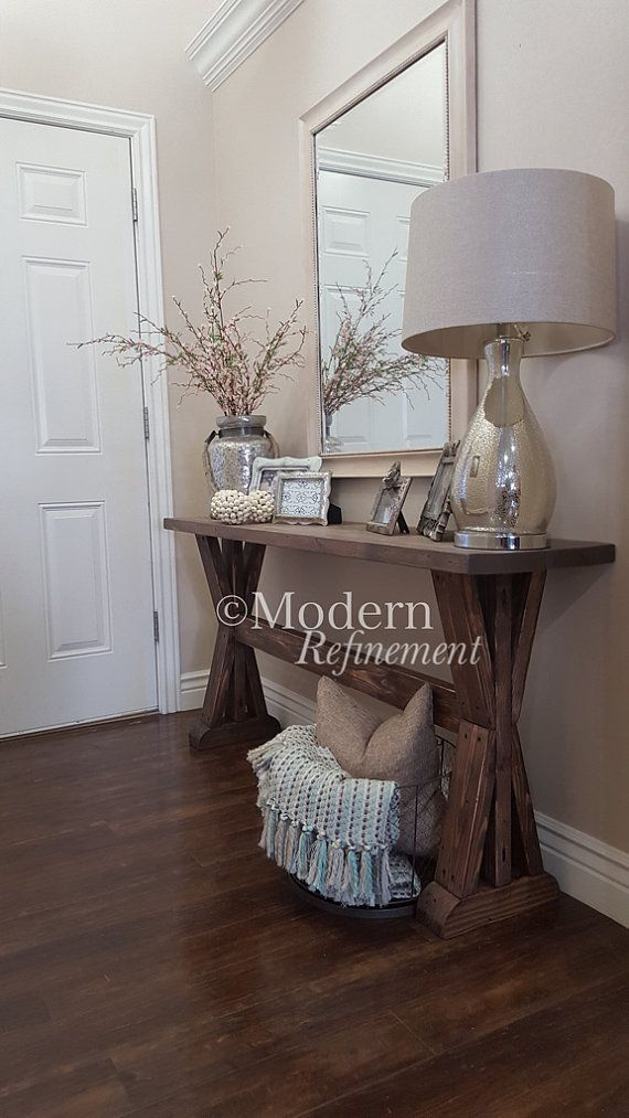 Stunning handmade rustic farmhouse entryway table. Just the right accent piece to add to your home. The table is handmade, solid wood and treated with a lovely weathered stain. Has a protective finish to bring out the woods natural beauty. These tables can be customized with any dimensions as well as color combinations. Message me for more details.   Dimensions 60 wide 30 tall 14 deep  Entryway table. Farmhouse. Rustic. Buffet. Sofa table. Table. Entry way. Stained. Stain. Wood. Solid wood…