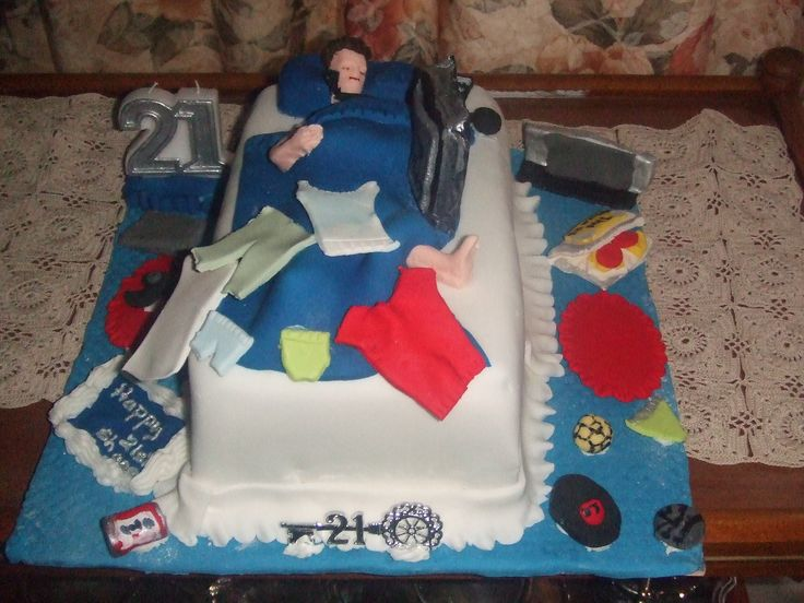 """21st cake bed scene with clothes, TV, PlayStation, drink can,  computer  Cakes For All Occasions (""""Cake Talk With Margaret"""" ) Mosgiel Otago New Zealand  website: www.icedcakes.co.nz"""
