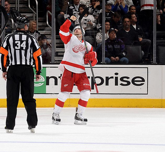 Tomas Tatar points to the sky after scoring the game winning goal against The Kings on Saturday night.  HIs father had died the day before.  Jan 11 2014