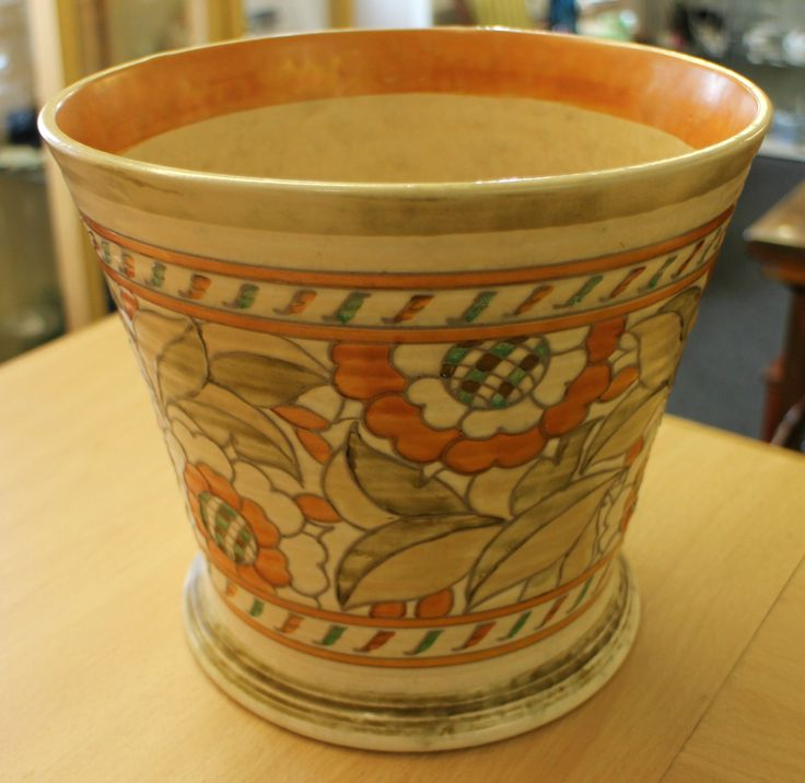 Charlotte Rhead Tudor Rose jardinière. Full markings to base. Excellent condition, no damage. Height measures 8 inches. Top diameter measures approximately 9 inches. Nice vibrant colours.
