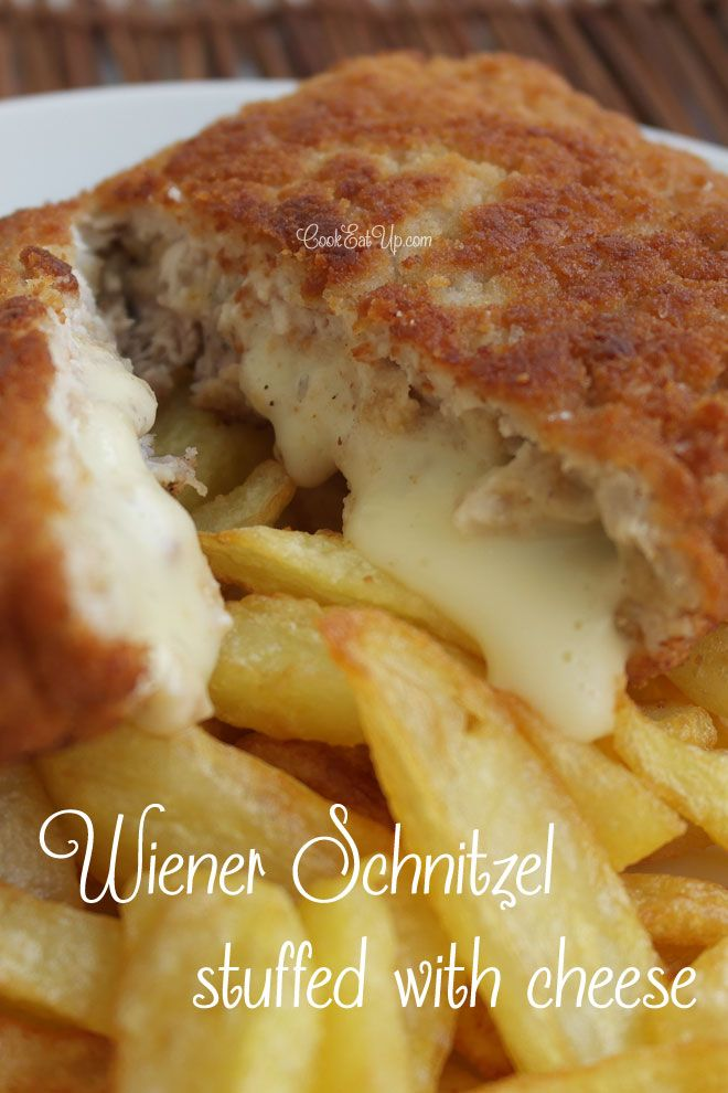 Wiener Schnitzel Stuffed with Cheese ~ 4 pork scallops, thin slices, 2 cups flour, 2 cups breadcrumbs, 2 eggs beaten, 8 slices cheese like La vache qui rit, or Kraft singles, Salt and pepper, and Vegetable oil for frying.