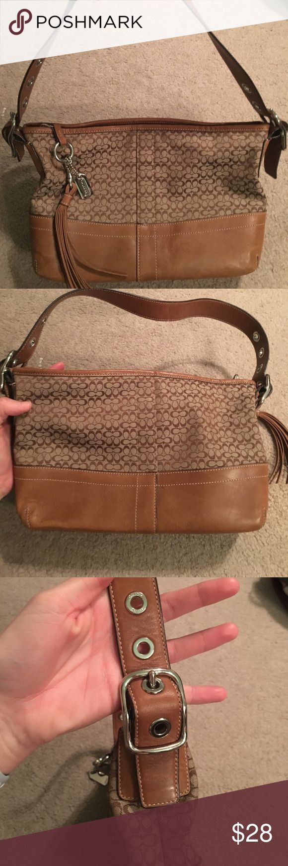 Tan and Brown Canvas and Leather Coach Purse Good condition. Wear to exterior leather like scratching and rubbing. Interior is clean! Coach Bags