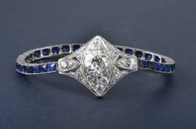 A beautiful Edwardian (circa 1910) platinum bracelet with French cut sapphires and a center old European cut diamondBeautiful Edwardian, Edwardian Approx, Diamonds Bracelets, European Cut Diamonds, French Cut, Circa 1910, Platinum Bracelets, Diamond Bracelets, Cut Sapphire