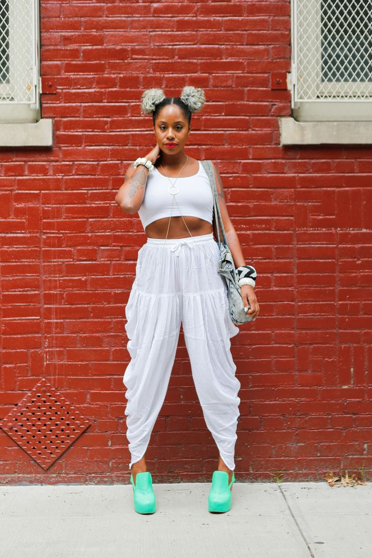 The 13 Best Looks From Afropunk Fest #refinery29  http://www.refinery29.com/2014/08/73448/afropunk-street-style#slide12  Following her performance at the festival, Tecla struck a pose in her white crop top, coordinating loose pants, and turquoise clogs. Oh, and check out those double buns.
