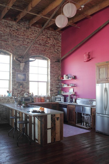 Brick walls, big windows, bold color, salvaged wood, stainless steel, wood floor. by Antonio Ballatore.