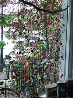 Suncatcher / window hanger with a lot of beads and shells