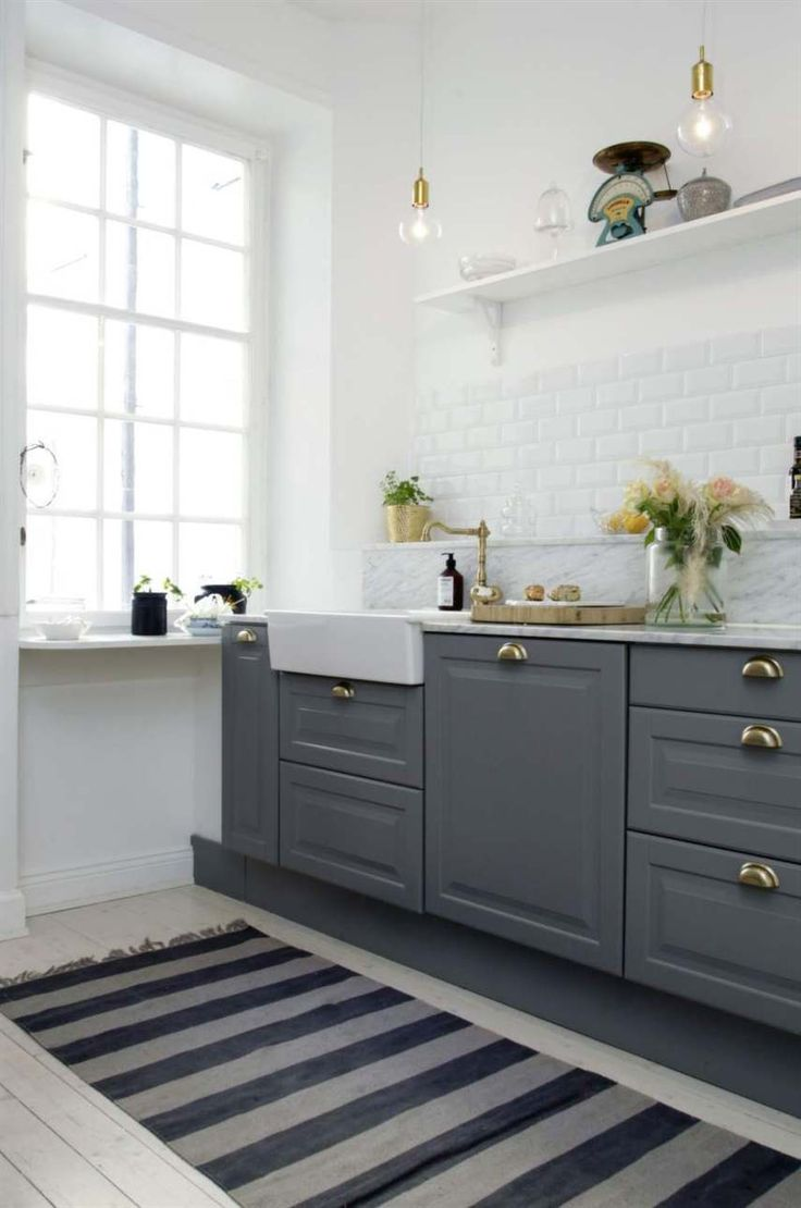 Gorgeous grey kitchen with brass details