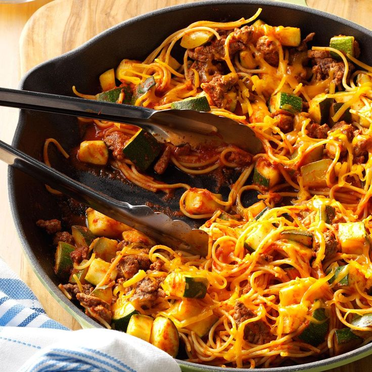 Southwestern Spaghetti Recipe -Chili powder and cumin give a mild Mexican flavor to this colorful one-skillet supper. With chunks of fresh zucchini, it's a nice change of pace from typical spaghetti dishes. —Beth Coffee, Hartford City, Indiana