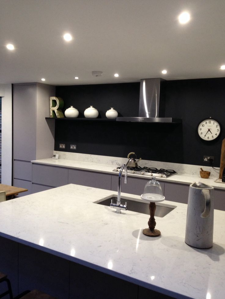 Industrial kitchen, cabinets by Matthew Smith, marble worktop and off black F&B wall