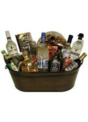 The ultimate cocktail gift basket! Everything you need to get your bar started is packaged in this oversized copper tub! Includes Gordons Gin 750ml, Sirrings Simple Syrup, Mr & Mrs. T