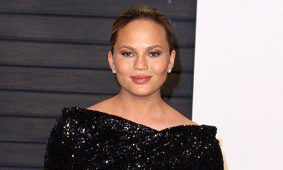 Chrissy Teigen Exposed! Model Flashes Nipples in Black Panel Dress