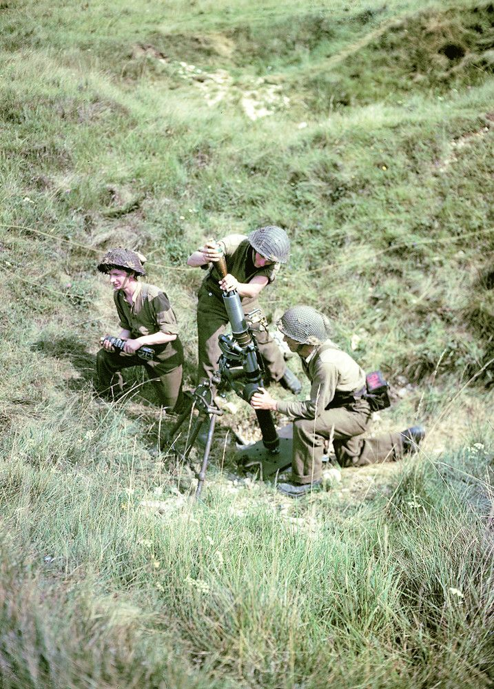 Soldiers of the 3rd Canadian Infantry Division set up a mortar on Juno Beach on the outskirts of Bernieres-sur-Mer on June 6, 1944.
