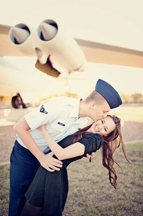 Air force flight pilot coming home to girlfriend! So cute that he's kissing the side of her face so you can see how happy she is.