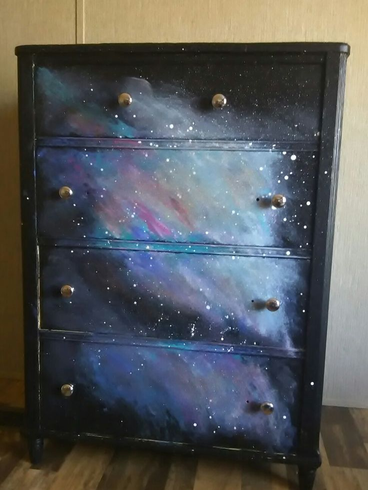 Galaxy Print Dresser! I painted this old hand me down dresser for my daughter. With swirls of blues, pinks, and purples. Splattered on some white paint, and brushed on some glitter paint.