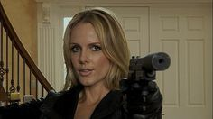 "Monet Mazur as a silencer-wielding hitwoman in The Good Guys ""The Whistleblower."""