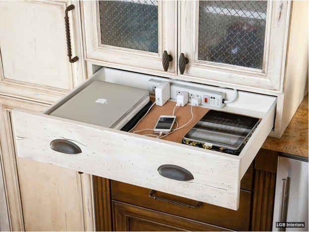 Keep your charging station in a kitchen or nightstand drawer, just by drilling some holes. Loveeeee this idea