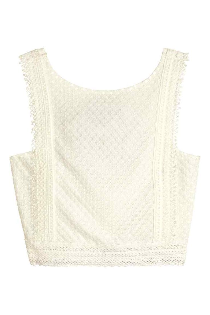 Lace crop top: Cropped top in lace with a low-cut back and wide shoulder straps. Jersey lining.