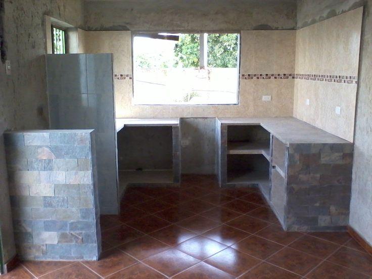 Cocina en mamposteria recubierta con ceramica y laja rectificada, otro proyecto con feliz termino.