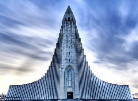 The Hallgrímskirkja (literally, the church of Hallgrímur) is a Lutheran parish church located in Reykjavík, Iceland. At 74.5 metres (244 ft), it is the fourth tallest architectural structure in Iceland. The church is named after the Icelandic poet and clergyman Hallgrímur Pétursson (1614 to 1674), author of the Passion Hymns. State Architect Guðjón Samúelsson's design of the church was commissioned in 1937; it took 38 years to build it.