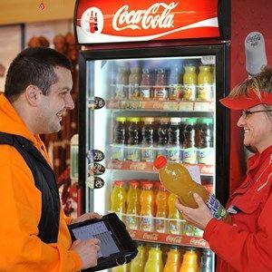 Coca-Cola HBC representative with a customer