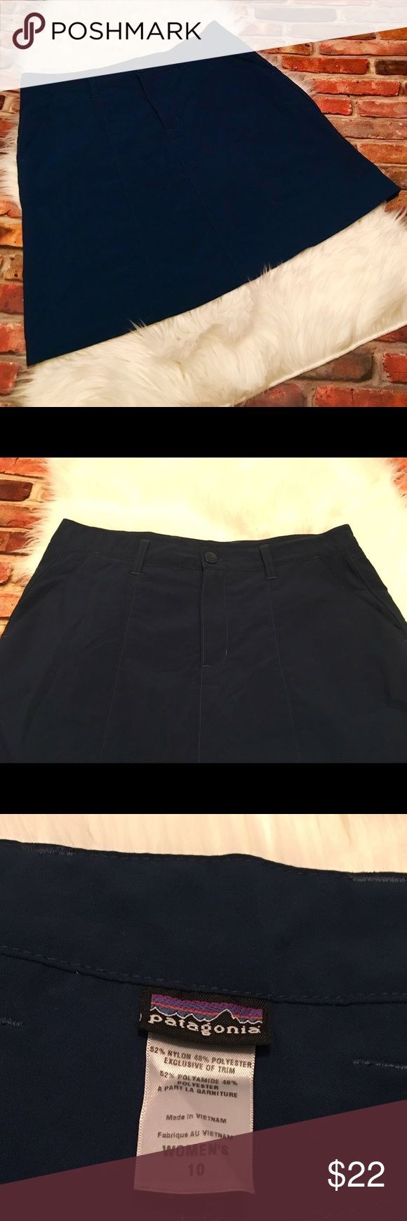 Patagonia Skort Size 10 Preowned Patagonia Skort. Size 10. Has two front pockets & two zipper pockets on back.  52% Nylon & 48% Cotton. Has built in shorts. Zips & buttons on front. This has been preloved & is in excellent condition. (It was hard to capture true color of this, it's a medium bluish like color. It is NOT navy blue). Measurements are approximate. See all pictures as you will receive as pictured. No trades/No holds. Reasonable offers are welcome. Bundle & save $$. Thanks for…