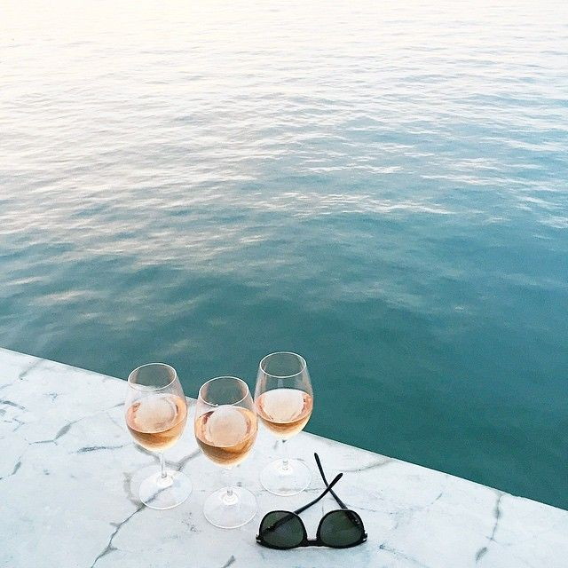 Girlfriends wine by the ocean - great representation of fun and relaxation