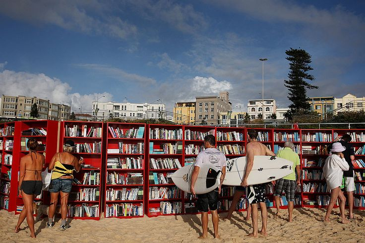 Red book cases on the beach