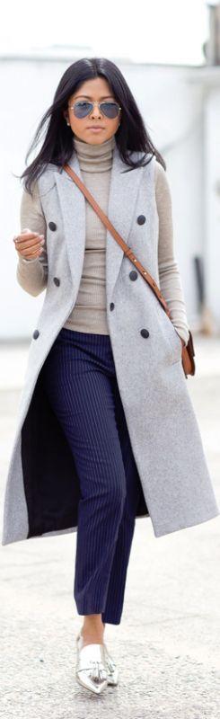 Grey sleeveless trench coat.