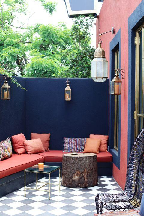 Moroccan inspired outdoor entertaining nook on the patio. Checkered floors, global styling and a bold palette.