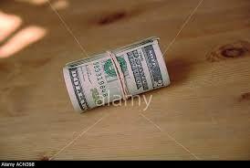 Afbeeldingsresultaat voor dollar bills on a table