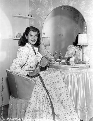 Rita Hayworth 1918 - 1987  vintage Hollywood stars and burlesque performers at their dressing tables. I love the way that each woman's femininity is enhanced by being pictured next to, or using their dressing tables. These photos are a real celebration of star power, glamour and female allure...