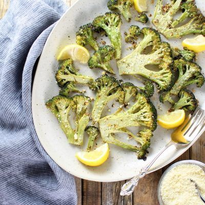 Roasted Ranch Broccoli Recipe: Roasted with olive oil, lemon, & ranch… finished with Parmesan cheese. Super simple, healthy, & yummy!