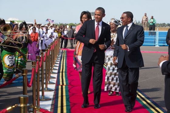 President Obama and President Jakaya Kikwete of Tanzania, along with the First Lady and Salma Kikwete, watch performers during an arrival ceremony at Julius Nyerere International Airport in Dar es Salaam, Tanzania.