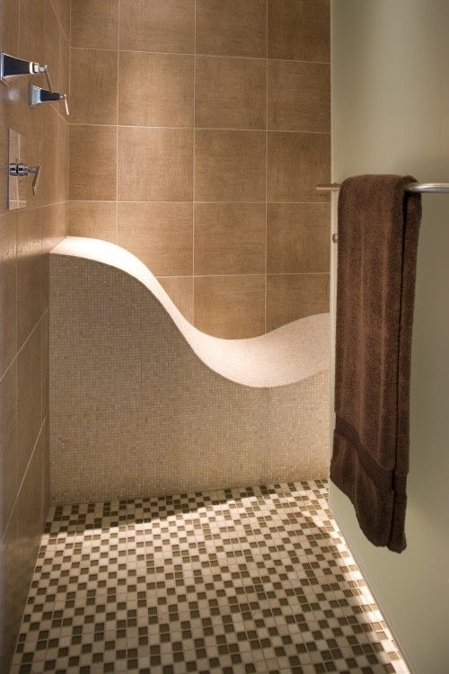 the sensual lines of this undulating shower seat offer an inviting spot to perch eclectic bathroom by john kraemer u0026 sons