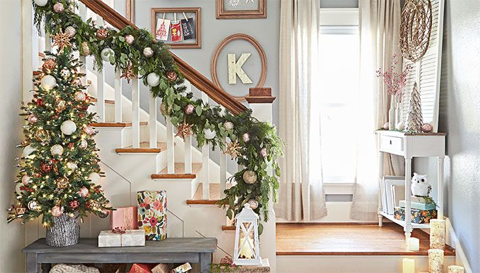 Stairway With Decorated Garland On Banister Art On Walls