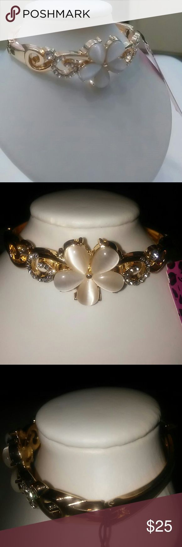 😃😃New with tags bracelet Gardenia Betsy Johnson 😃😃Sale Last Drop😃😃😃😃New with tags Betsy Johnson Gardenia Flower bracelet never worn used comes in a Beautiful black  Storage box. This bracelet is gorgeous shines so pretty  A white flower in front looks like a pearl appearance  With silver rhynestones on both  sides All Pictures taken by me this bracelet is astonishing  I love it  Only one available Accessories