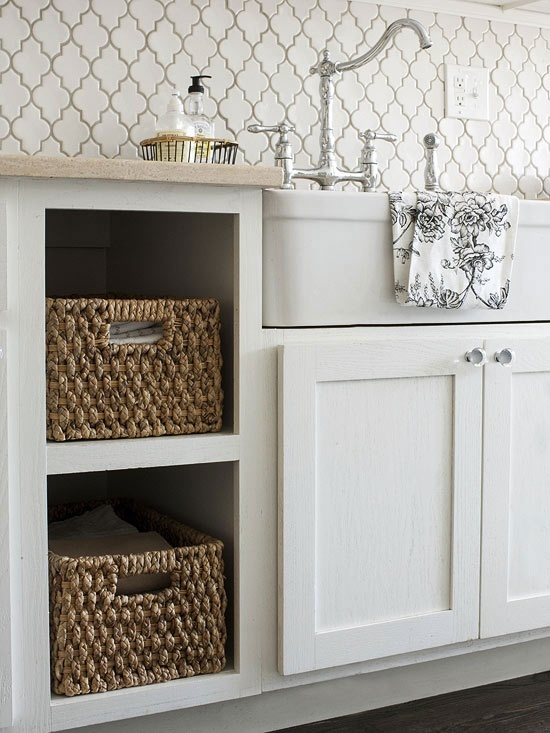 Adding open shelving with baskets creates a nice contrast and interest to a white kitchen