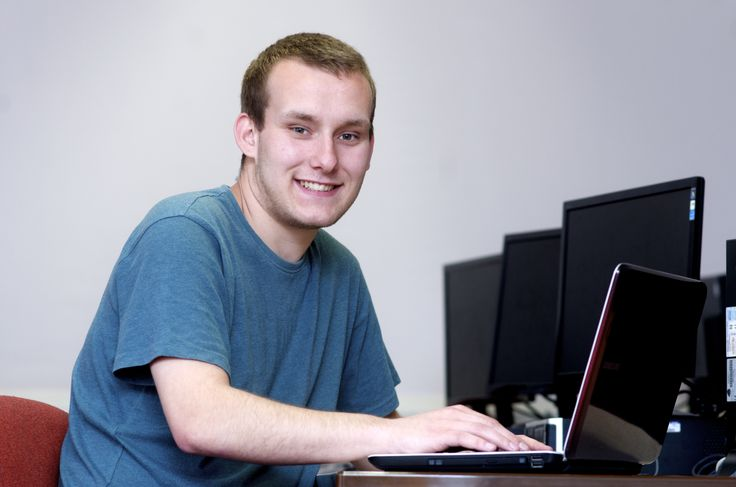 An IT student working hard on his latest assignment.