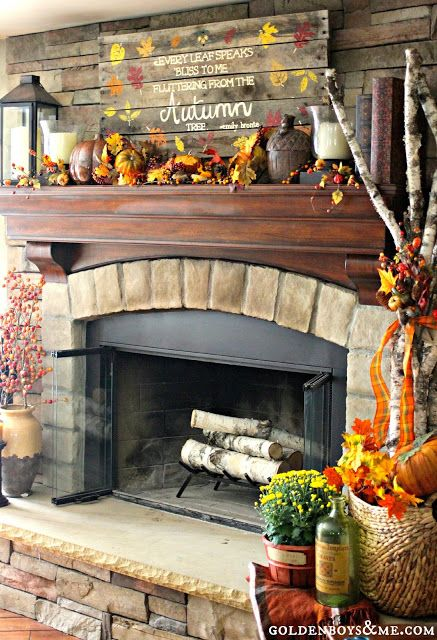 palllet sign and lantern with birch logs on stone fireplace, part of fall mantel