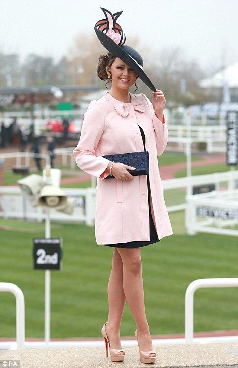 Jennifer Wrynne from Ireland poses for a photo during Ladies Day at Cheltenham Racecourse, 12/03/14