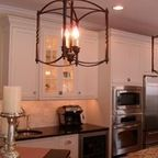 http://www.houzz.com/photos/7511349/Lighting-with-architectural-stone-and-antiques--Mediterranean-Style--mediterranean-kitchen-lighting-and-cabinet-lighting-new-york