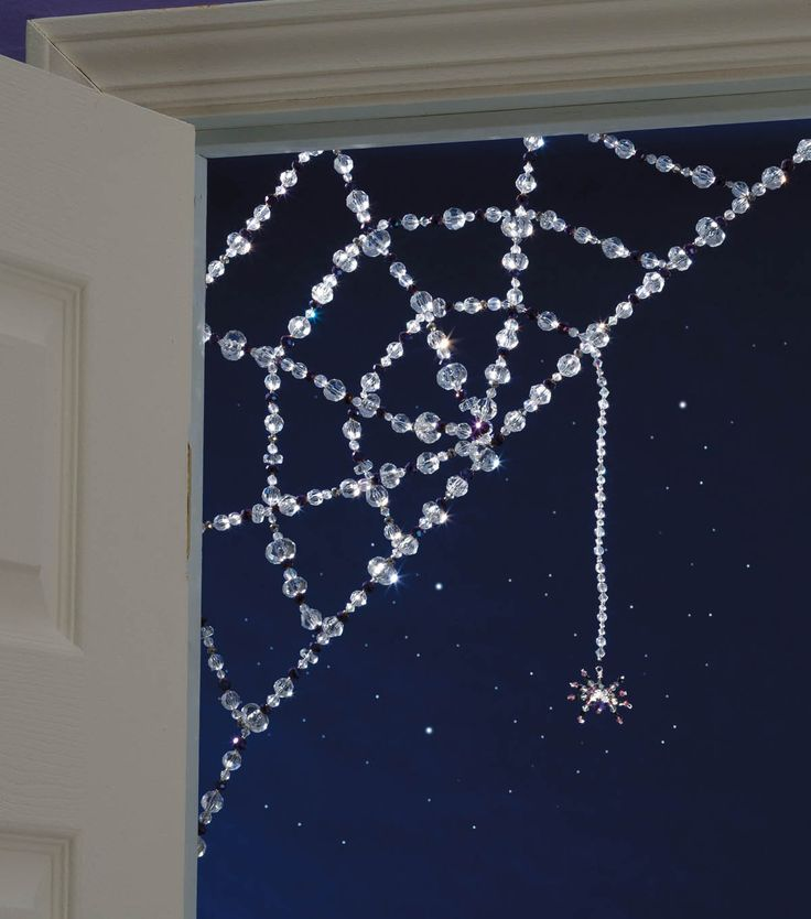 Dazzle up your Halloween decor with a beaded spider web! Or do the same thing with glue gun and wire