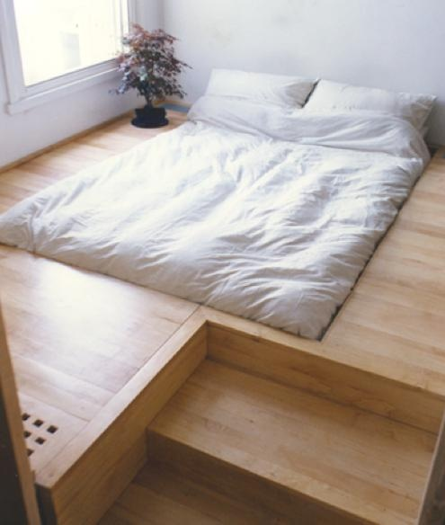 minimalist living - elevated floor as bed