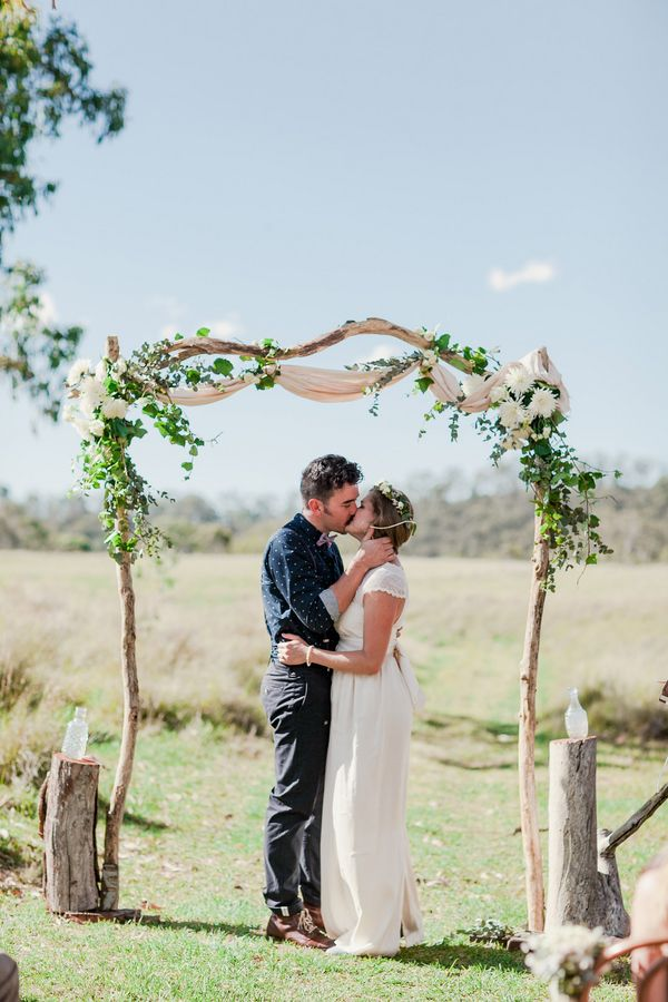 Gorgeous floral arch l Oli Sansom Photography l Read more http://www.rusticfolkweddings.com/2014/08/04/camp-wedding/ #ceremony #greenweddings