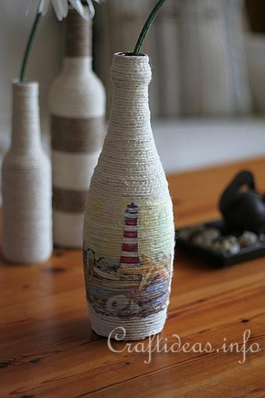 Good idea for the recycling and/or craft badge. Take a glass bottle and cover it with double stick tape, then wrap jute around it. If you want to put a picture on it, then mod podge a napkin with a design on it. I've made this and it turned out great!