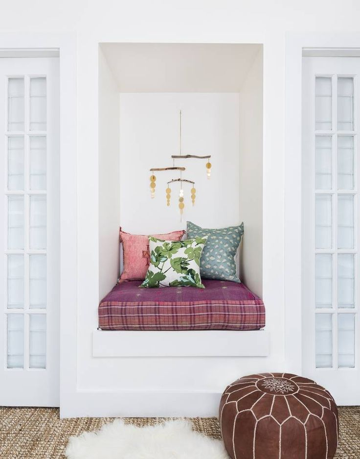 I have a serious soft spot for this little nook, in the family room. We upholstered the cushion in a vintage Kantha and I love it.